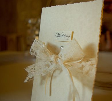 Traditional wedding invitation bringing together a beautiful cream vintage